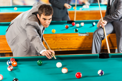 Businessman playing snooker.
